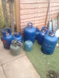 8 empty gas bottles