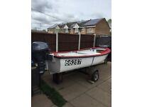 15hp Yamaha outboard with boat and trailer.
