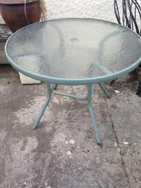 Round glass topped garden table