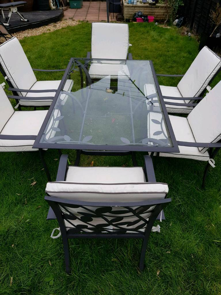 Homebase garden table and 6 chair set with cushions
