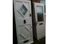 Exterior hardwood door with frosted glass diamond panel