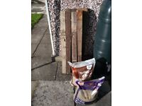 7 Used Fence Posts Good Condition Plus Two Bags Sand