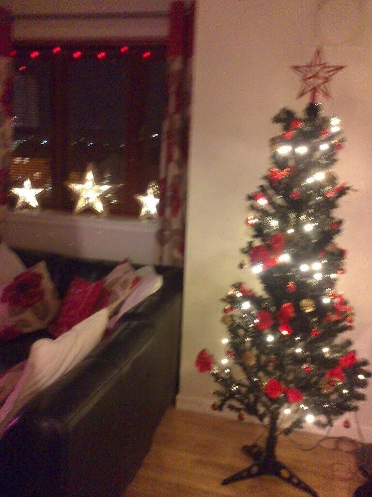 black christmas tree with red and gold decorations