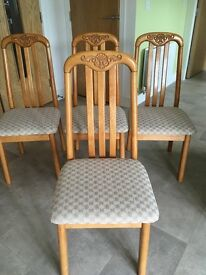 Pine circular dining table and 4 matching chairs
