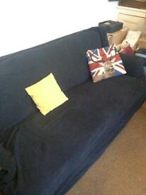 3 persons sofa 3 seaters very comfy comfortable with large throw to cover