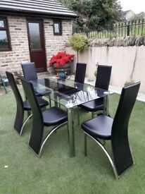 glass dinning table with 6 leather and crombe chairs