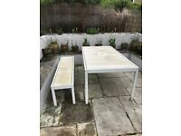 Large white outdoor table and bench