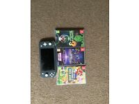 Nintendo switch lite and 3 games