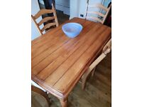 Excellent condition solid oak Welsh dresser, dining table and 4 chairs.