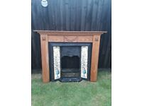 Black Cast Iron Fireplace and Wooden Surround