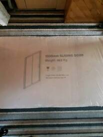 1300x700mm shower tray with polished chrome sliding doors