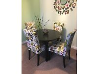 Dark brown dining table with floral fabric chairs