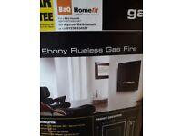 Ebony wall mounted flueless gas fire. Brand new. Still in box
