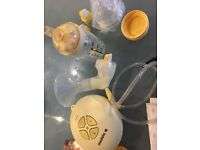 Medela Swing Breast Pump and accessories.