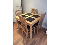 Solid oak dining table with granite squares, 4 leather/solid oak chairs - quality