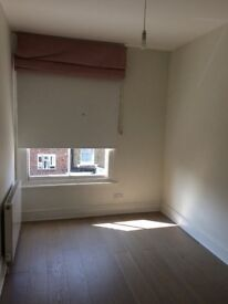 Bright airy room to let