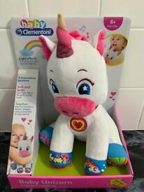 Brand new in box, baby unicorn, sings and lights up