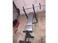 Weights bench and dumbbells.