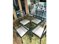 Wrought iron & glass dining room table with 4 chairs