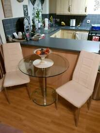 Round glass dinning table & two chairs