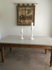 Pine farmhouse dining table with painted top and 4 chairs. Can be sold separately.