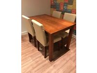 Dinning table and 4 cream chairs