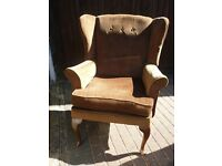 """For Sale Parker Knoll Type brown wing back chair. 41"""" tall and 32"""" at wings."""