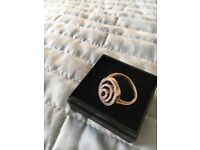 Yellow gold diamond swirl ring with lovely designer look.