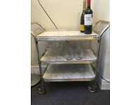 Vintage drink trolley with glasses