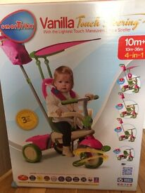 Pink and green smart trike for 10 months +