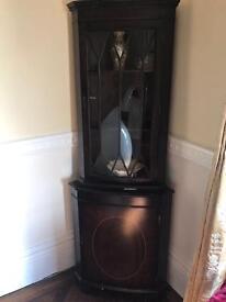 Dark wooden corner cupboard