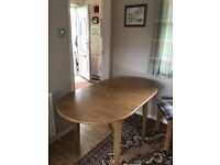 Pine extendable dining table.
