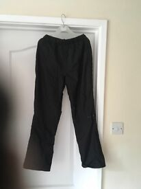 Kids black waterproof trousers. Peter Storm age 11-12
