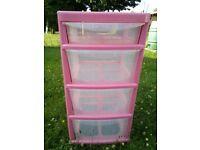 "Pink storage drawers on wheels 30""h x 15""w x 15.5""d"