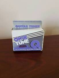 Guitar tuner boxed with instructions