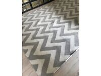 Handwoven grey chevron flatweave rug. 120cm by 180cm. Great condition.