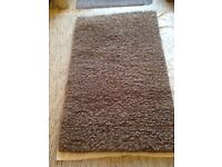 Thick woolen rug. 150cm X 90cm. Brown. Excellent condition. Hardly used.