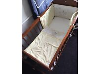 Very good condition crib with bedding and matterass