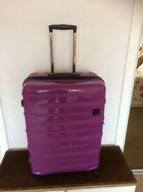 Large purple Tripp Suitcase.
