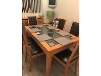 Dining table six chairs storage unit and small lamp table