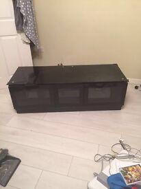 Black TV stand 3 door glass top.
