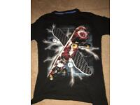 Black flipback short sleeved t shirt with skateboard on it age 11-12