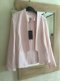 Marks and Spencer's woman's pale pink blaser. Never worn. Tags still attached. Size 8.