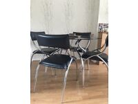 Round Black glass table & x4 chairs 1100 x 1100mm