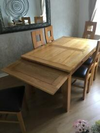 Oak extender dining table with 6 chairs
