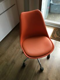 Orange hydraulic office chair