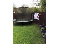 Lovely 12 ft trampoline with enclosure