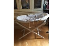 Moses basket with stand and removable hood. In good condition.