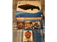 Playstation 4 with games and extra controller