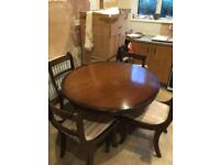 Dark wood folding table and four chairs